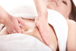 An image of a woman getting a fertility massage